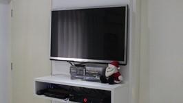 painel da TV da suíte do casal